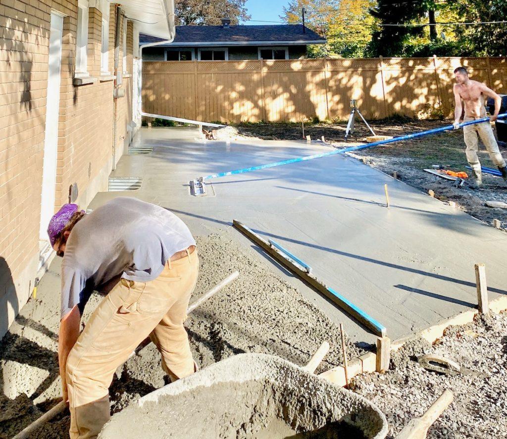 Backyard concrete patio pour