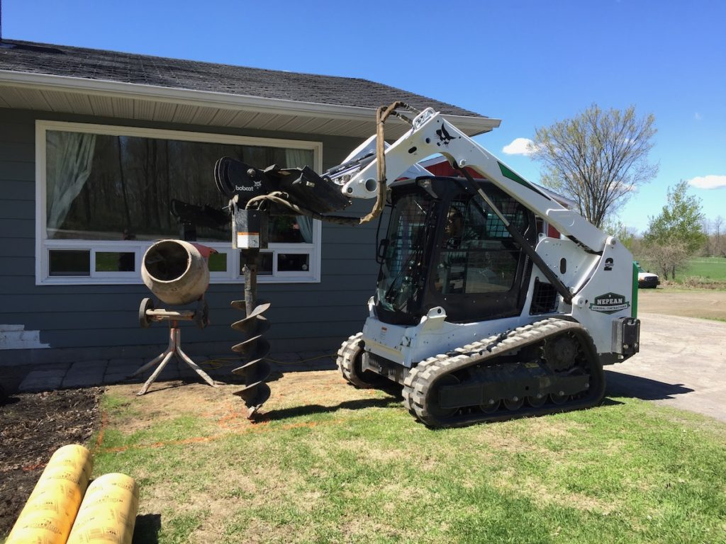 Skidsteer with Auger service Ottawa and Nepean